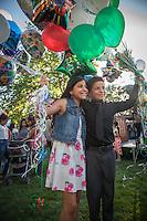 Twelve year old cousins Lindsay Caldera and Alex Escobedo celebrate at their graduation ceremony at Calistoga Elementary School