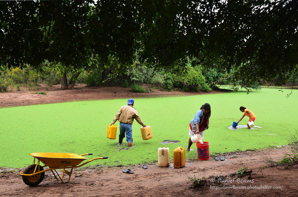 Guarani family carrying water
