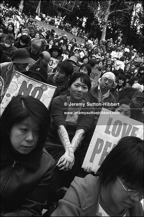Anti-Iraq war(2003) demonstration held in Hibiya Park, in the upmarket area of Ginza, Tokyo, Japan.