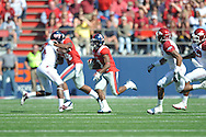 Ole Miss' Jeff Scott (3) runs vs. Arkansas at Vaught-Hemingway Stadium in Oxford, Miss. on Saturday, October 22, 2011. .
