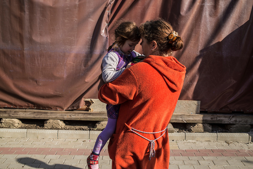 A woman and her daughter, part of a group of internally displaced people who fled the besieged city of Donetsk and are now living in a small seaside resort, on Tuesday, October 14, 2014 in Berdyansk, Ukraine. Photo by Brendan Hoffman, Freelance