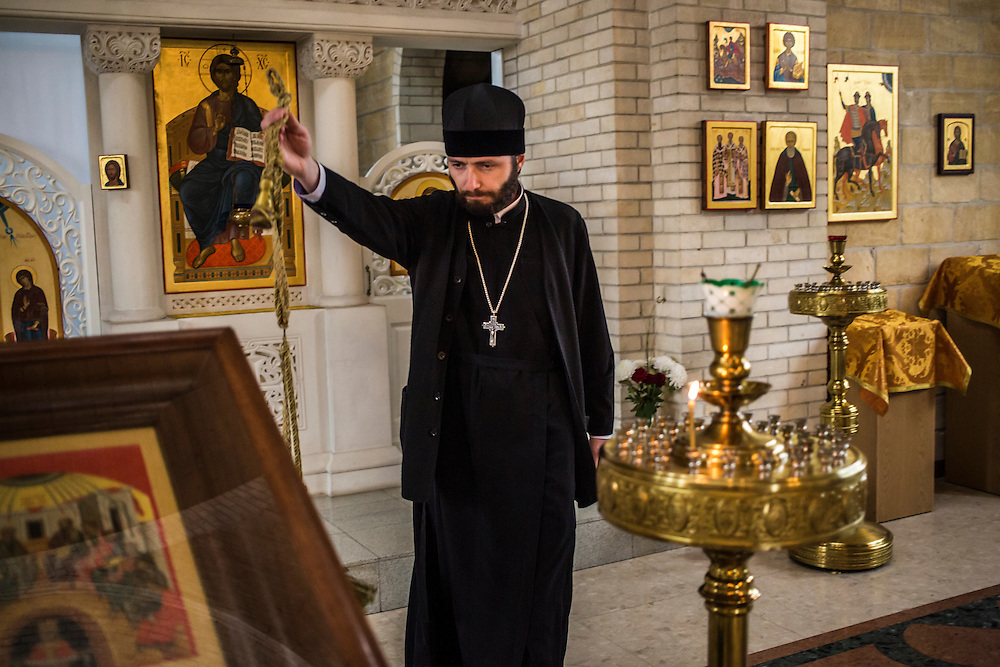 Father Sergiy, a pastor at The Church In the Name of the Holy Trinity, on Wednesday, October 15, 2014 in Berdyansk, Ukraine. Photo by Brendan Hoffman, Freelance