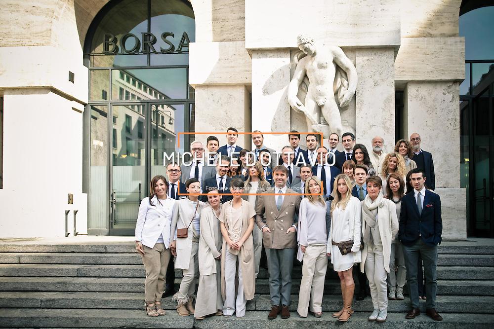 Brunello Cucinelli, re del cashmere, fondatore e proprietario dell'omonima azienda ritratto con i suoi dipendenti davanti alla borsa di Milano in occasione dell'ipo.<br /> <br /> Brunello Cucinelli, king of cashmere, portrait with his employees in front of the Milan Stock Exchange at the IPO.