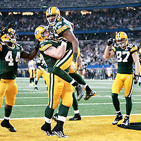 Green Bay Packers' Greg Jennings and Green Bay Packers' Scott Wells celebrate Jennings touchdown catch in the 2nd quarter..The Green Bay Packers played the Pittsburgh Steelers in Super Bowl XLV,  Sunday February 6, 2011 in Cowboys Stadium. Steve Apps-State Journal.