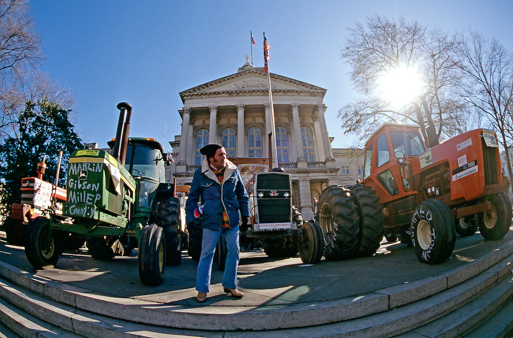 The American Agriculture Movement is an organization consisting primarily of small American farmers, and was formed in 1977 in Campo, Colorado by a group of farmers. The farmers attempted to organize a strike in which farmers would no longer buy or sell anything.<br /> <br /> The organization demanded that the federal government establish higher prices of various crops, claiming that they needed &quot;parity&quot; between what they had to spend to grow crops versus revenues received from their crops. One of the slogans of the group was &quot;Parity not Charity&quot;, as the farmers demanded that the government ensure that farmers were paid more for their crops. The farmers demanded to make as much profit per acre, adjusted for inflation, as farmers did at the turn of the 20th century.<br /> <br /> On December 10, 1977, approximately 5,000 farmers held a rally in Lincoln, Nebraska, and were joined by Nebraska governor J. James Exon. The farmers all rode their tractors, and soon other farm states had tractor rallies. Gloria Carter Spann, sister of President Jimmy Carter even participated in one rally.<br /> <br /> While the farmers appeared to have widespread sympathy, relatively few farmers actually went on strike and refused to grow crops. The organization therefore decided to have a tractor rally in Washington, DC. In January 1978, nearly 3,000 farmers drove their tractors to Washington, many of them from thousands of miles away.The Carter administration agreed that the Farmers Home Administration would stop all foreclosures, but soon after the rally was over resumed foreclosures of farms with past due loans.