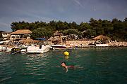 Travel in Croatia<br /> <br /> Swimming in a bay inside the Pakleni Islands near Hvar.<br /> <br /> June 2013<br /> Matt Lutton