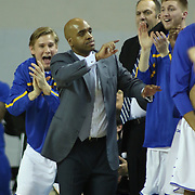 Delaware Men's Head Coach Monté Ross and the Hen's bench celebrate as the come with three points after being down 20points in the second half of a NCAA regular season Colonial Athletic Association conference game between Delaware and The College of Charleston Wednesday, Feb 5, 2014 at The Bob Carpenter Sports Convocation Center in Newark Delaware.