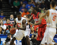 Ole Miss' Reginald Buckner (23) vs. Florida's Patric Young (4) in the SEC championship game at Bridgestone Arena in Nashville, Tenn. on Sunday, March 17, 2013.