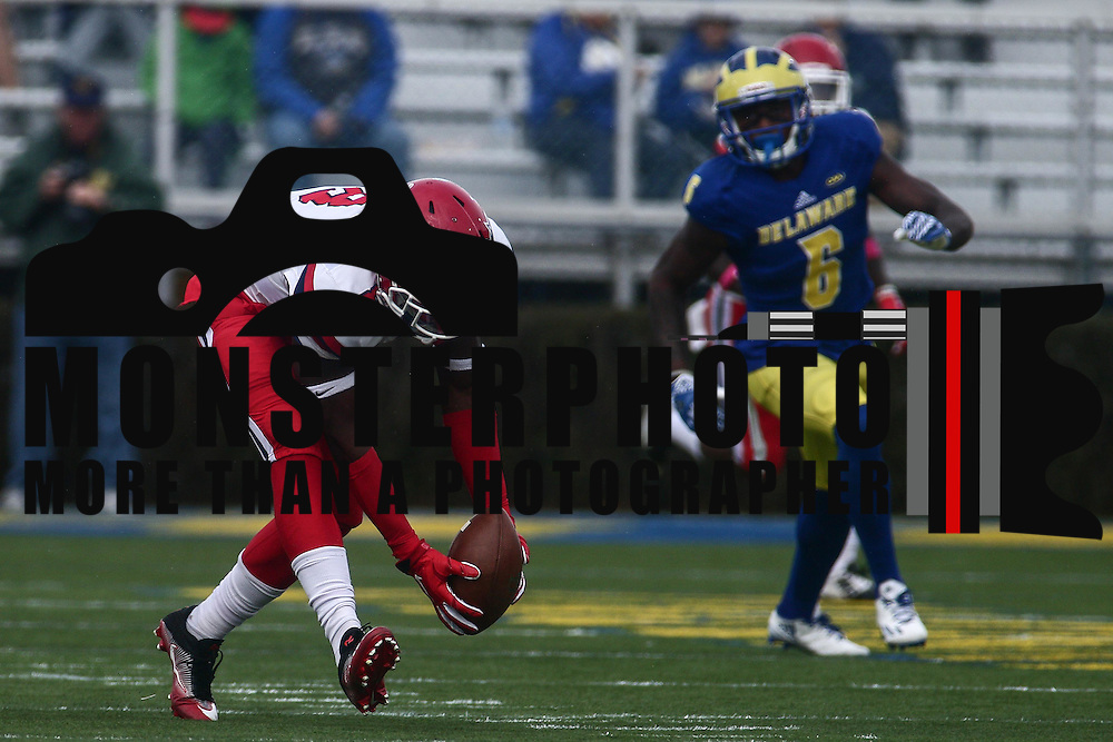 Stony Brook defensive back JAHEEM WOODS (8) recovers the fumble and returns it 55 yards during a week eight game between the Delaware Blue Hens and the Stony Brook Seawolves, Saturday, Oct. 22, 2016 at Tubby Raymond Field at Delaware Stadium in Newark, DE.
