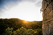 """Christine Shiba climbing """"No Place Like Home,"""" 5.11c, at the Red River Gorge in Kentucky. Photography by Kris Ugarriza"""