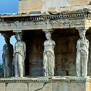 "Caryatids support the southern portico of the Erechtheion, the most sacred sanctuary on the Acropolis, in Athens, Greece, Europe. The Erechtheion and the ""Porch of the Maidens"" was built entirely of marble between 421 and 406 BC. Between 1800 and 1803, one of the caryatids was removed by order of Lord Elgin to decorate his Scottish mansion, and was later sold to the British Museum in London (along with the pedimental and frieze sculpture taken from the Parthenon). Athenian legend had it that at night the remaining five Caryatids could be heard wailing for their lost sister. Elgin attempted to remove a second Caryatid; but when technical difficulties arose, he tried to have it sawn to pieces. The statue was smashed, and its fragments were left behind. It was later reconstructed haphazardly with cement and iron rods. In 1979, five original Caryatids (sculpted female figures serving as an architectural support) were moved to the Acropolis Museum in Athens and replaced in situ by exact replicas. The Acropolis of Athens and its monuments were honored as a UNESCO World Heritage Site in 1987."