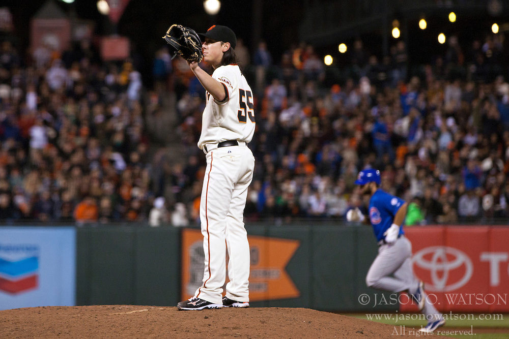 August 29, 2011; San Francisco, CA, USA;  San Francisco Giants starting pitcher Tim Lincecum (55) reacts after giving up a three run home run to Chicago Cubs left fielder Blake DeWitt (back) during the seventh inning at AT&T Park.