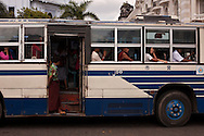 A full bus in the streets of the biggest city of Myanmar, Yangon. Burma.<br />