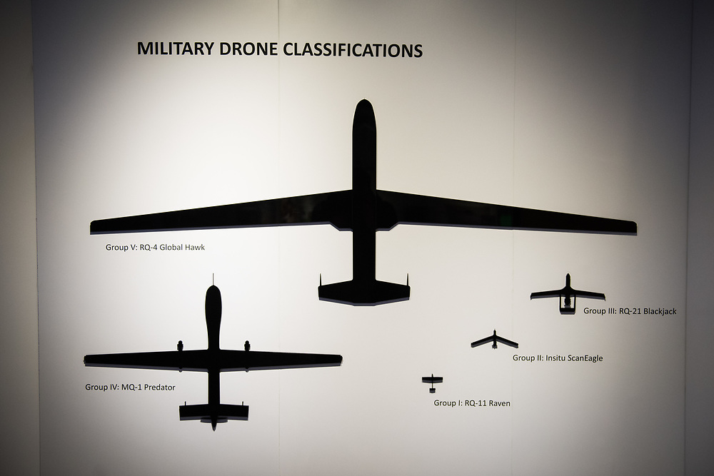"""30206010A - DRONES - The scales of different military drones are displayed at the """"Drones: Is the Sky the Limit?"""" exhibit at the Intrepid Sea, Air, and Space Museum in New York, NY on May 9, 2017."""