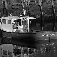 B&amp;W Massachusetts photography of Rockport Harbor featuring the red fishing boat Gussy's Girls on a beautiful sunset night. This harbor is located on Cape Ann, north of Boston. <br />