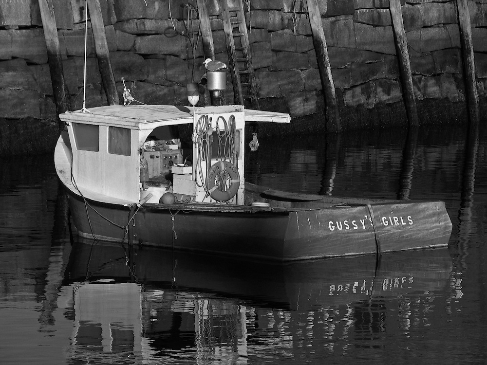 B&amp;W Massachusetts photography of Rockport Harbor featuring the red fishing boat Gussy's Girls on a beautiful sunset night. This harbor is located on Cape Ann, north of Boston. <br /> <br /> This classic New England harbor scenery photography image is available as museum quality photography prints, canvas prints, acrylic prints or metal prints. Fine art prints may be framed and matted to the individual liking and decorating needs:<br /> <br /> http://juergen-roth.pixels.com/featured/near-gloucester-juergen-roth.html<br /> <br /> Good light and happy photo making! <br /> <br /> My best, <br /> <br /> Juergen<br /> Website: www.RothGalleries.com<br /> Twitter: @NatureFineArt<br /> Facebook: https://www.facebook.com/naturefineart<br /> Instagram: https://www.instagram.com/rothgalleries<br /> Photo Blog: http://whereintheworldisjuergen.blogspot.com