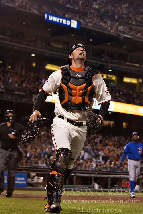 August 29, 2011; San Francisco, CA, USA;  San Francisco Giants catcher Chris Stewart (front) chases a foul ball against the Chicago Cubs during the fifth inning at AT&T Park. Chicago defeated San Francisco 7-0.