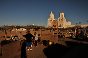 Tohono O'odham vendors sell fry bread at Mission San Xavier del Bac in Tucson, Arizona, USA.