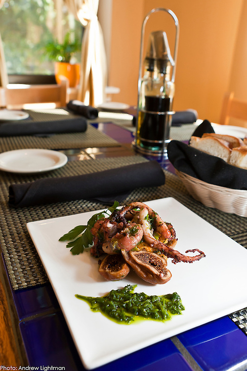 A succulent calamari graces Toscana's pastel interior.