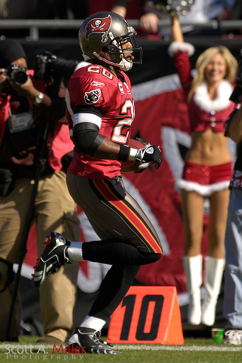 Dec. 23, 2007; Tampa, FL, USA; Tampa Bay Buccaneers cornerback Ronde Barber (20) returns and interception for a touchdown during the Bucs game against the Atlanta Falcons at Raymond James Stadium....©2007 Scott A. Miller