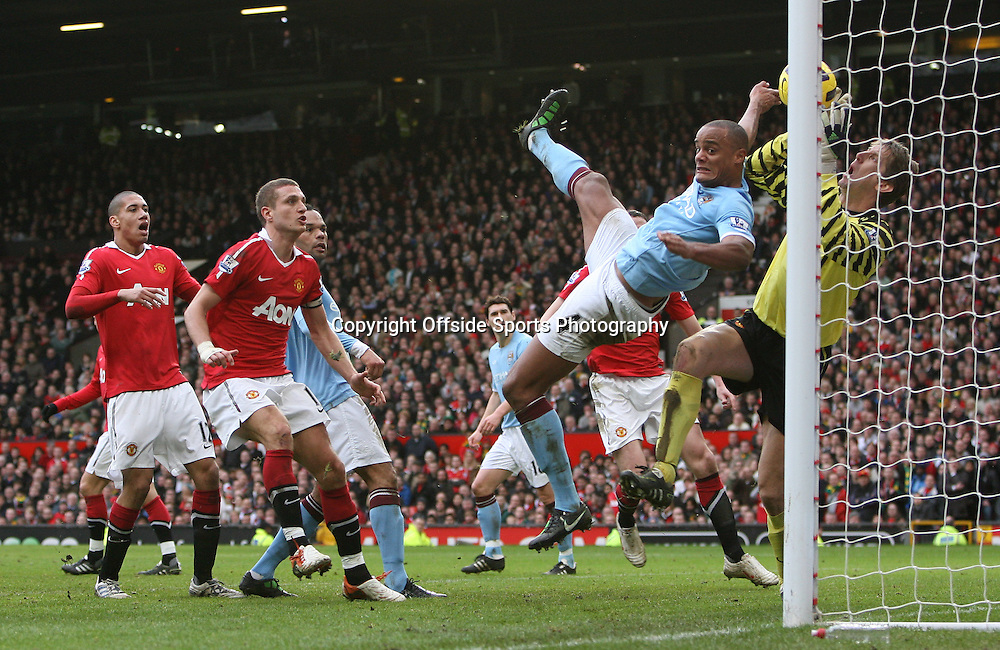 12/02/2011 - Barclays Premier League - Manchester United vs. Manchester City - Man Utd goalkeeper Edwin van der Sar tangles with Vincent Kompany of Man City in the goalmouth - Photo: Simon Stacpoole / Offside.