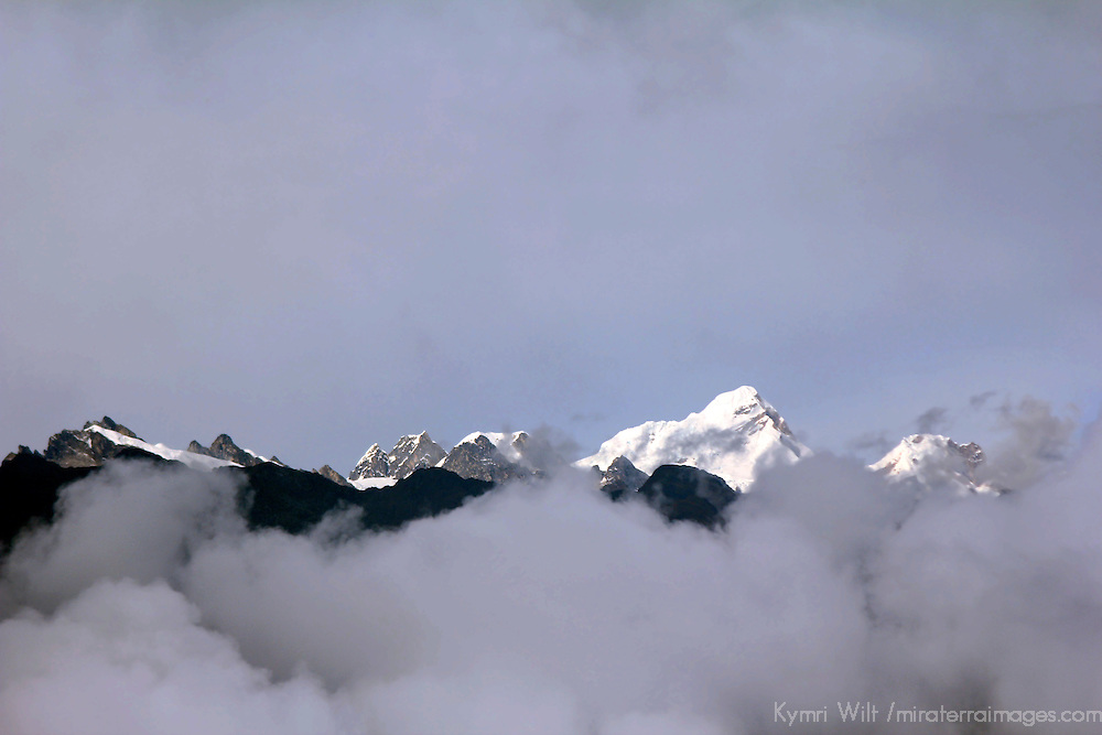 South America, Peru, Urubamba. Andean Peaks and clouds.