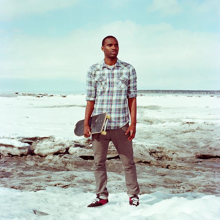 ANCHORAGE, AK - APRIL 2012: Skateboarder Preston Pollard in downtown Anchorge, Alaska. .
