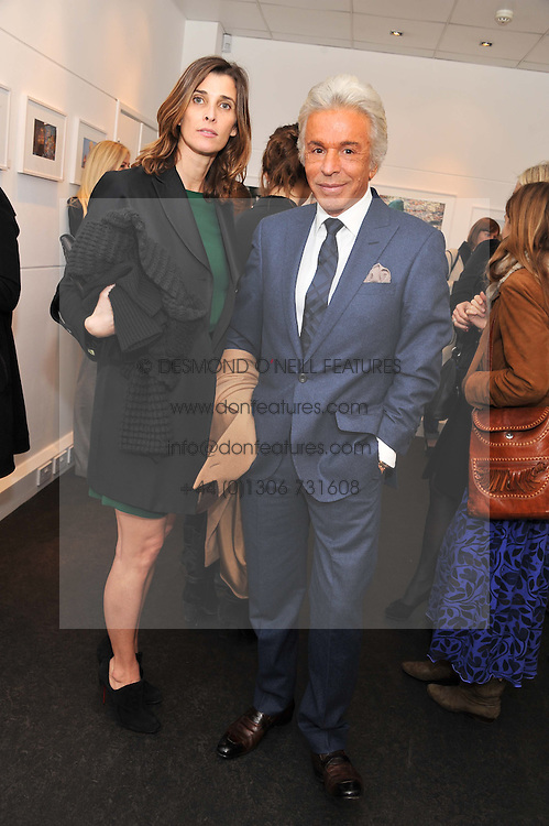 PRINCESS ROSARIO SAXE-COBURG and GIANCARLO GIAMMETTI at a private view of photographs by Anthony Souza held at The Little Black Gallery, 13A Park Walk, London SW10 on 13th December 2011.