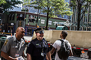 Police officers walk through the Uptown area where the Democratic National Convention will take place this week on Sunday, September 2, 2012 in Charlotte, NC.