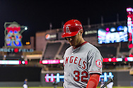 Josh Hamilton #32 of the Los Angeles Angels heads to the dugout after losing to the Minnesota Twins on April 16, 2013 at Target Field in Minneapolis, Minnesota.  The Twins defeated the Angels 8 to 6.  Photo: Ben Krause
