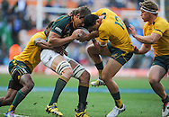 CAPE TOWN, SOUTH AFRICA - Saturday 28 September 2013, Eben Etsebeth of South Africa is tackled by Christian Lealifano of Australia during the Castle Lager Rugby Championship test match between South Africa (Sprinkboks) and Australia (Wallabies) at DHL Newlands in Cape Town.<br /> Photo by Roger Sedres/ ImageSA