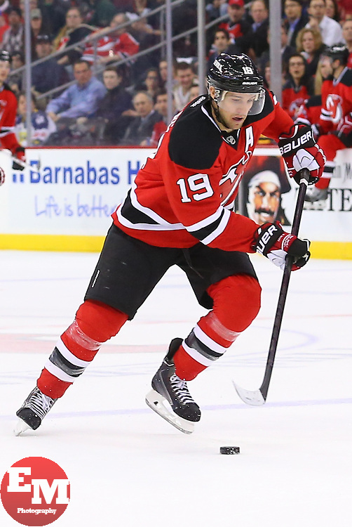 Mar 31, 2014; Newark, NJ, USA; New Jersey Devils center Travis Zajac (19) skates with the puck during the first period at Prudential Center.