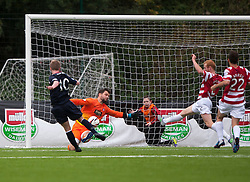 Hamilton's Kevin Cuthbert saves from Falkirk's Craig Sibbald.<br /> Half time : Hamilton 1 v 0 Falkirk, Scottish Championship played today at New Douglas Park.<br /> &copy;Michael Schofield.