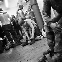 MINERS CHANGING AFTER THEIR TEN HOURS SHIFT UNDERGROUND AT LONGANNET COLLIERY, CULROSS. SCOTLAND, APRIL, 2001.