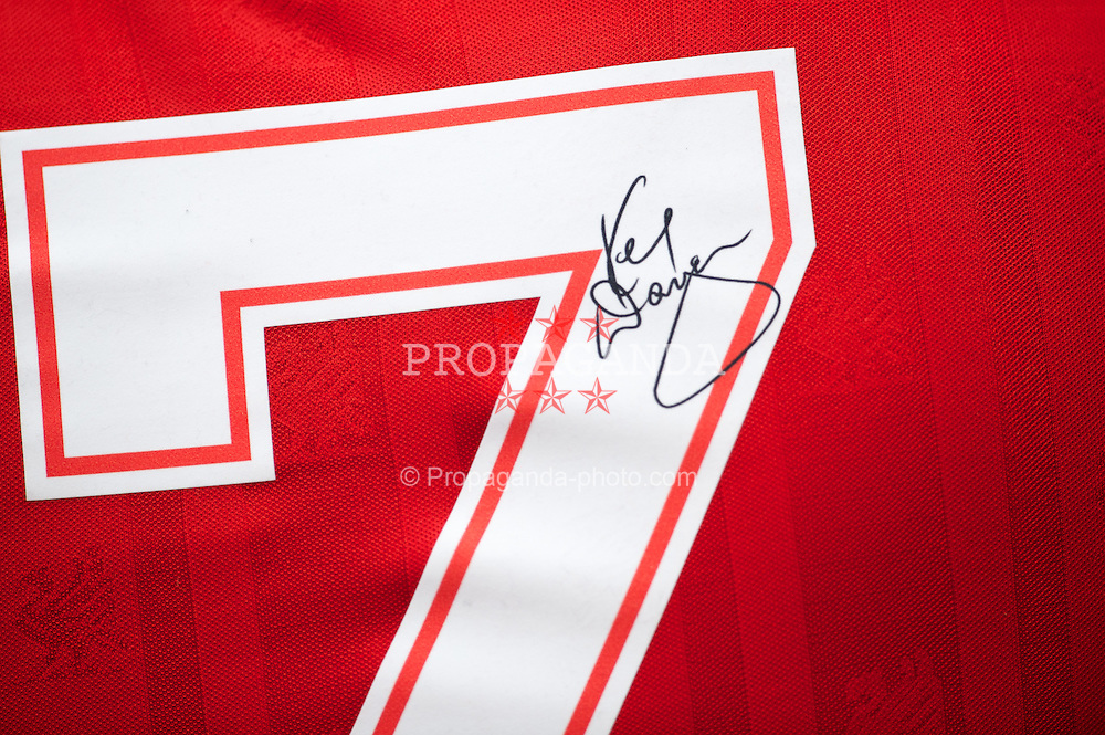 LONDON, ENGLAND - Sunday, February 27, 2011: A Liverpool supporter with his shirt signed by manager Kenny Dalglish before the Premiership match against West Ham United at Upton Park. (Photo by David Rawcliffe/Propaganda)