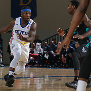 Delaware 87ers Guard NATE ROBINSON (1) drives towards the paint as Greensboro Swarm Guard MARDRACUS WADE (5) defends in the second half of an NBA D-league regular season game between the Delaware 87ers and the Greensboro Swarm (Charlotte Hornets) Wednesday, March 29, 2017, at The Bob Carpenter Sports Convocation Center in Newark, DEL