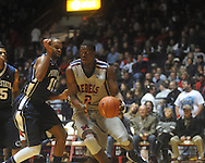 "Ole MIss forward Reginald Buckner (2) dribbles against Penn State forward David Jackson (15) at the C.M. ""Tad"" Smith Coliseum on Friday, November 26, 2010. Ole Miss won 84-71."