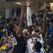 12/30/11 Newark DE: Temple Senior Guard #10 Jake Godino shoots the ball over Delaware Junior Forward #32 Josh Brinkley during a NCAA basketball game against Delaware Friday, Dec. 30, 2011 at the Bob carpenter center in Newark Delaware...Rahlir Jefferson-Hollis led the Owls with 13 points and eight rebounds, Anthony Lee added a career-high 12 points, seven rebounds, and three blocks, Juan Fernandez contributed 11 points, and Ramone Moore chipped in with 10 points and a game-high six assists.