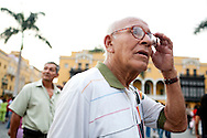 A man walks through Plaza de Armas on Saturday, Apr. 11, 2009 in Lima, Peru.