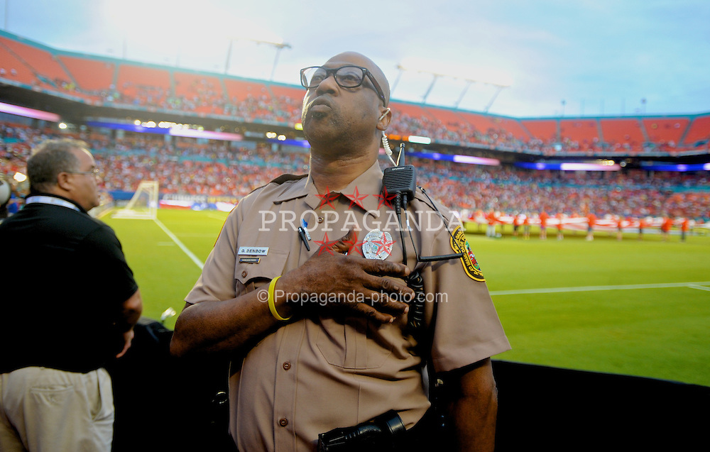 MIAMI, USA - Monday, August 4, 2014: An American policeman stands for the national anthem during the International Champions Cup Final match at the SunLife Stadium on day fifteen of the club's USA Tour. (Pic by David Rawcliffe/Propaganda)