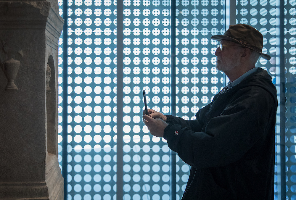 U of T professor Tim Kennedy photographs a sculpture with his iPhone at the Tampa Museum of Art.