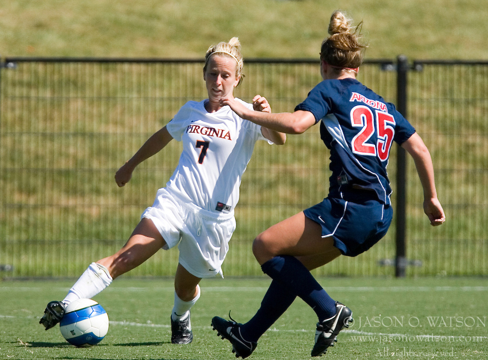 Virginia Cavaliers F/M Caitlin Miskel (7) dribbles around Arizona Wildcats F Jacqueline Zinke (25)..The Virginia Cavaliers women's soccer team defeated the Arizona Wildcats 4-0 in the 2007 Nike Soccer Classic at Klockner Stadium in Charlottesville, VA on September 16, 2007.  The Cavaliers won the tournament with a record of 2-0-0.