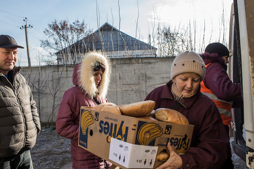 Volunteers from the Good Word Protestant Church deliver bread that will be distributed to local residents in need on Thursday, December 10, 2015 in Mariinka, Ukraine.