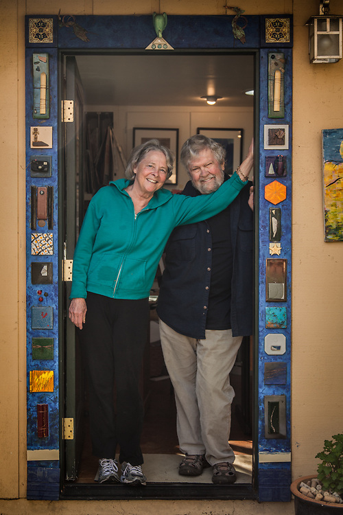Humorist Yvonne Henry and her photographer husband, Chick Harrity, in the door of their sharred Calistoga backyard office.