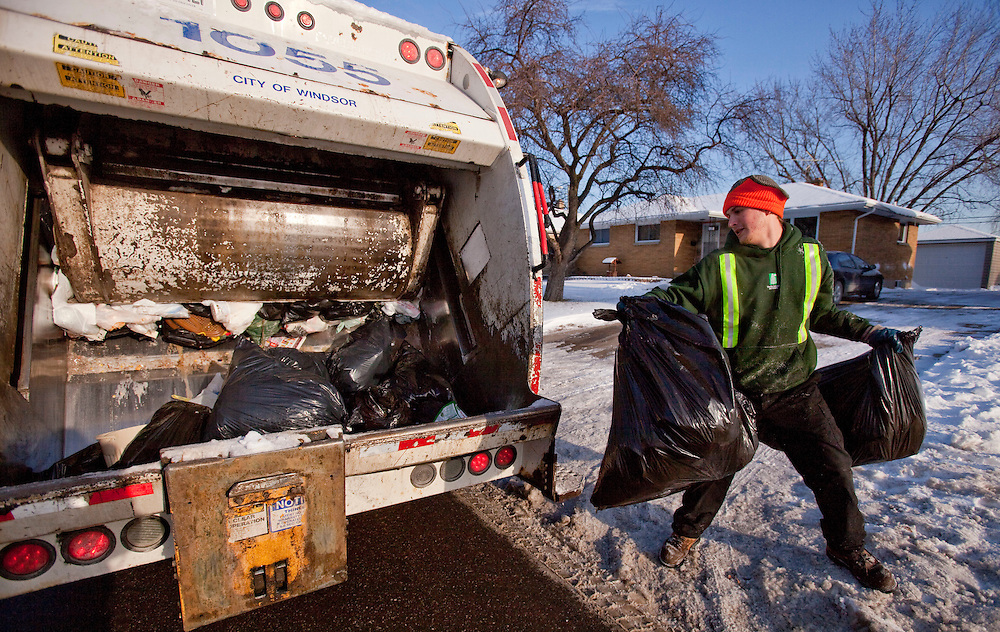 Windsor, Ontario ---10-12-16--- Will Peters of Turtle Island Recycling picks up garbage in Windsor, Ontario, December 16, 2010. The private company has recently taken over responsibility for garbage pickup from the city.<br /> GEOFF ROBINS The Globe and Mail