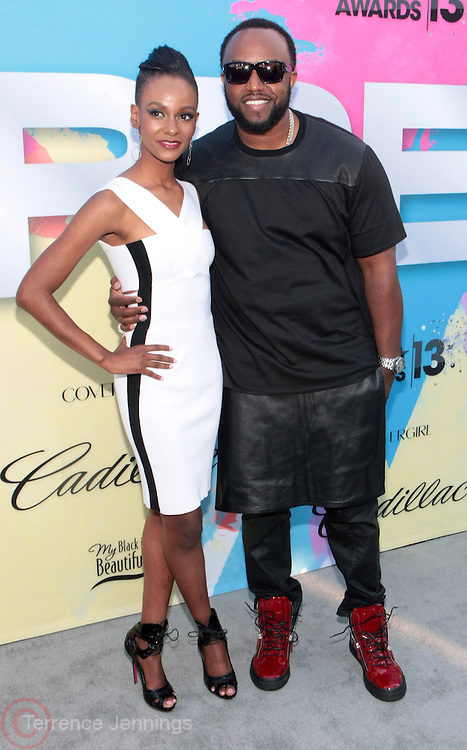 """Los Angeles, CA-June 29: (L-R) Recording Artist Tiara Thomas and Producer Rico Love attend the Seventh Annual """" Pre """" Dinner celebrating BET Awards hosted by BET Network/CEO Debra L. Lee held at Miulk Studios on June 29, 2013 in Los Angeles, CA. © Terrence Jennings"""