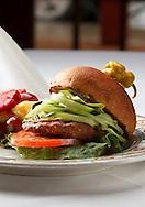 Turkey burger with cocumber, avacado,tomatoe and lettuce on a whole wheat bun.
