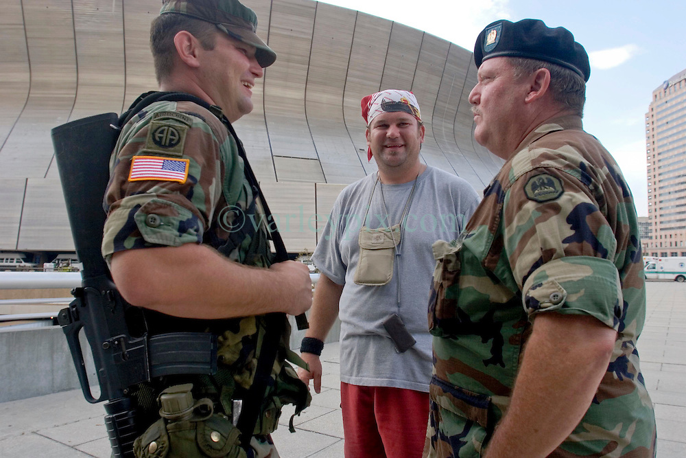 31st August, 2005. The tourist saviour. Staff Sergeant Garland Ogden (rt) who saved tourists from 'Hell on earth.' with (mid) Anthony (Bud) Hopes and Spc Forest Vinson outside the Superdome in New Orleans, Louisiana where over 20,000 refugees from hurricane Katrina are crammed into hellish conditions. Bud Hopes, an Australian from Brisbane said, 'if it wasn't for Sgt Ogden's help we would never have made it out of the Superdome. It was hell in there. He has taken exceptional measures, above and beyond the call of duty, totally beyond the scope of his job, an exceptional man. He has the blessing of all the international tourists. it is incredible to think that so many of the armed forces here have lost their own homes and yet they are gathered here to help all these people. It is the most amazing thing I have seen ion all my life.'<br /> Bud Hopes has become the 'leader' of the band of some 50 or so trapped tourists, caught up in the hell that is Hurricane Katrina and her aftermath. Sgt Ogden said of Bud, 'if he was a soldier, he would have made an excellent general.' <br /> Bud Hopes' parents can be contacted in Australia. Contact Diane and Eric Hopes on 011 617 492 65646