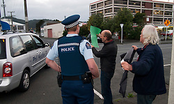 Local MP and Minister of Energy and Resources Phil Heatley passes anti mining protesters as he leaves the  Northland Club in Whangarei after a visit there with the Prime Minister, Northland, New Zealand, July 26, 2012. Credit:SNPA / Malcolm Pullman