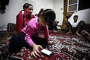 During an indiscriminately shelling by the artillery of the Assad-Army a family in Koreen seeks shelter at night in the ground floor of their house, as a six years old girl plays games on a smart phone.<br />